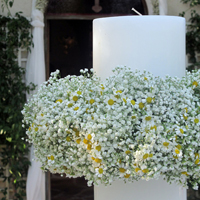 ::Wreathes of gypsophylle & tanacetum for the wedding candles