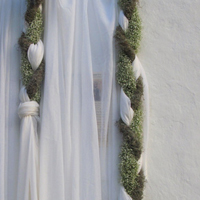 ::Hanging braids - chapel decor in Mykonos Island